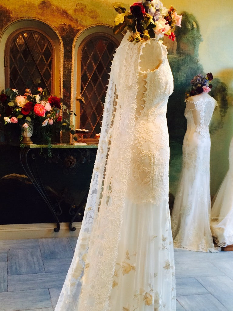 The piece de resistance featured a gorgeous and modern cape instead of a traditional veil.