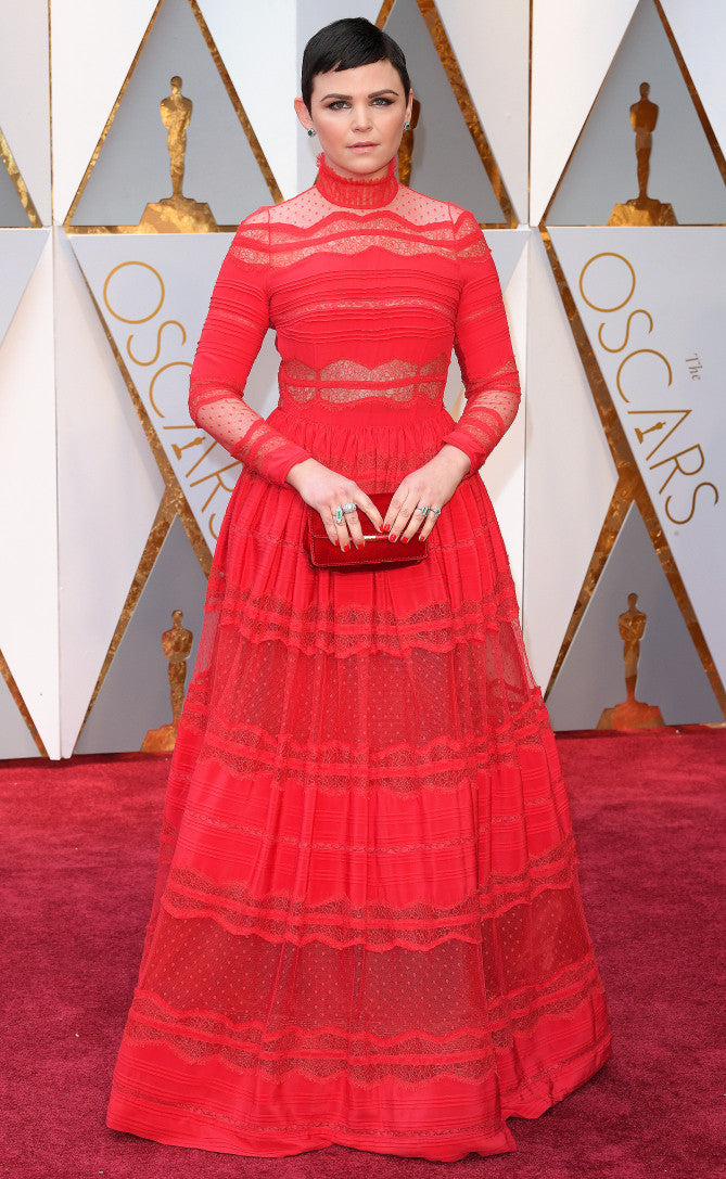 Ginnifer Goodwin attends the 2017 Oscars in a red lace dress