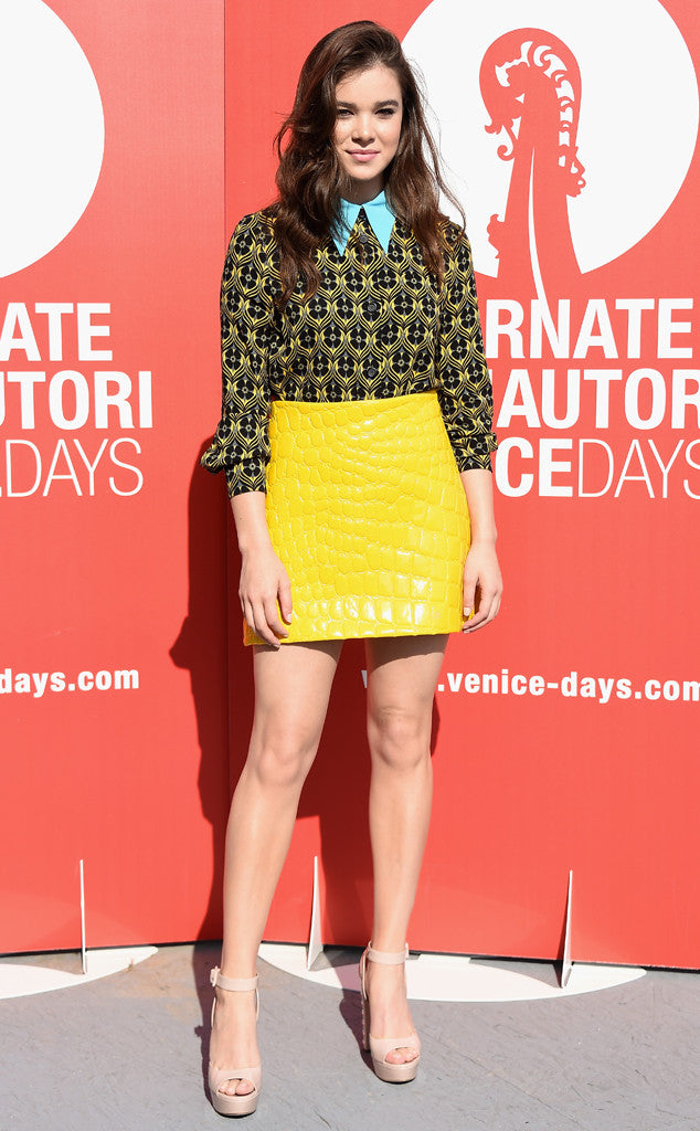 Hailee Steinfeld attended the Women's Tales press conference in a gorgeous textured yellow mini skirt and printed top.