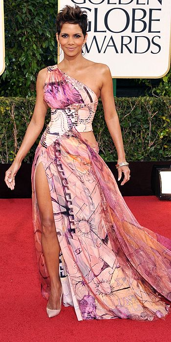 Halle Berry in Versace - Halle Berry can usually do no wrong in the fashion department but this printed mess with weird side cut out and side slit is a big miss for the actress. Too much skin and too much print is never a good combo