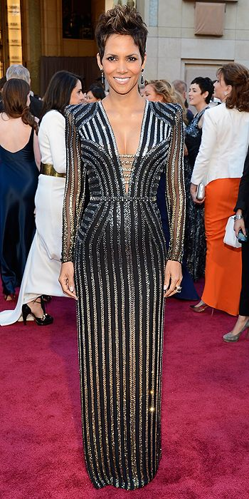 Halle Berry shimmered in a black and silver gown with exaggerated shoulders