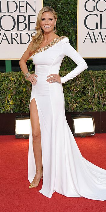 Heidi Klum in a one shouldered white gown with thigh high slit