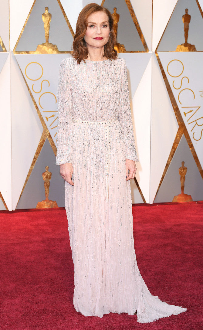 Best Actress Nominee, Isabelle Huppert attends the 2017 Oscars in a belted dress