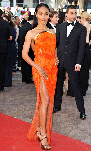 Jada Pinkett-Smith attends the premiere of Madagascar 3 in a gorgeous tangerine Atelier Versace gown with gold detail