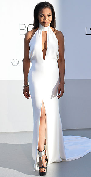 Janet Jackson attended the amfAR gala in a white Emilio Pucci halter