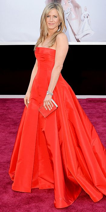Jennifer Aniston stepped out of her all black comfort zone and went for bright red Valentino