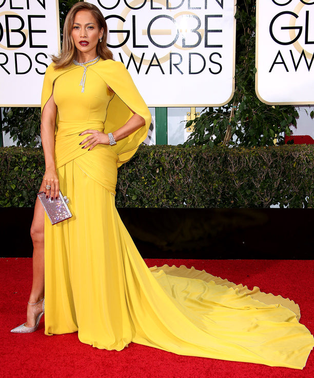 Jennifer Lopez came caped in a gorgeous marigold Giambattista Valli Haute Couture gown.