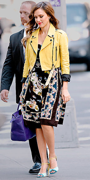 Jessica Alba added an extra pop of color to her Dolce and Gabbana dress with a yellow Burberry leather jacket