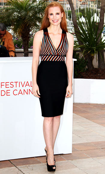 Jessica Chastain attends the photocall for Lawless in colorful Herve L. Leroux