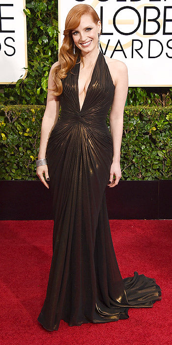 Jessica Chastain looked stunning in this bronze Atelier Versace halter with plunging neckline. We love seeing her pick colors that play off her alabaster skin and gorgeous red hair.