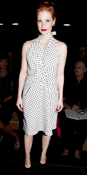 Jessica Chastain took in the Saint Laurent show in vintage polka dots from the brand