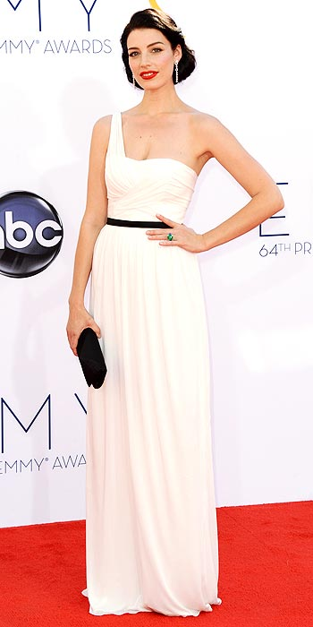 Mad Men's Jessica Pare attends the 2012 Emmy Awards in a Grecian inspired white dress cinched with a black ribbon