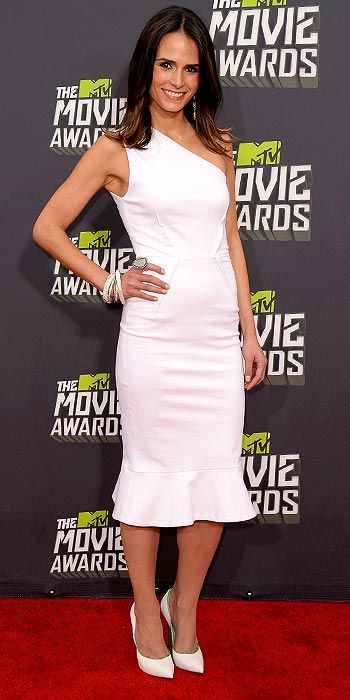 Jordana Brewster in a one-shouldered white dress