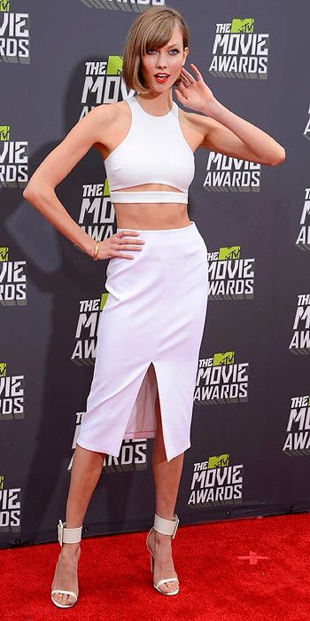 Model, Karlie Kloss showed a lot of skin in her all white look at the MTV Movie Awards