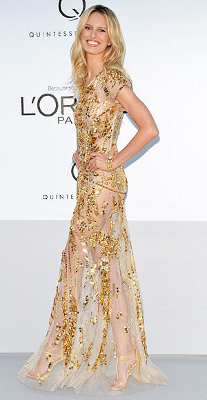 Karolina Kurkova attended the amfAR gala in a gold Roberto Cavalli number that left very little to the imagination