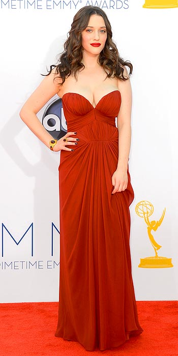 Kat Dennings in a crimson goddess style J. Mendel gown at the 2012 Emmy Awards