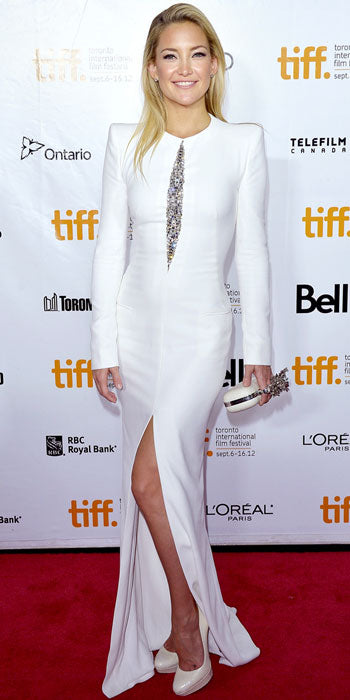 Kate Hudson showed off her fit form at the premiere of The Reluctant Fundamentalist in a white Alexander McQueen gown