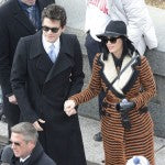 Katy Perry accompanied by John Mayer opted for a textured coat and fedora