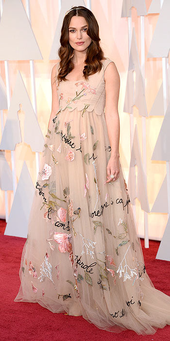 Keira Knightley's whimsical Valentino dress featured French phrases embroidered on her tulle skirt.