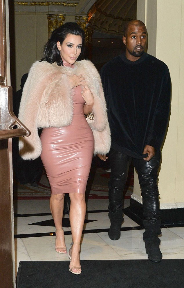 Kim Kardashian in pink latex dress and fur coat.
