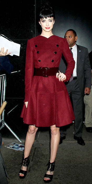Krysten Ritter was winter chic in a plum colored Robert Rodriguez coat
