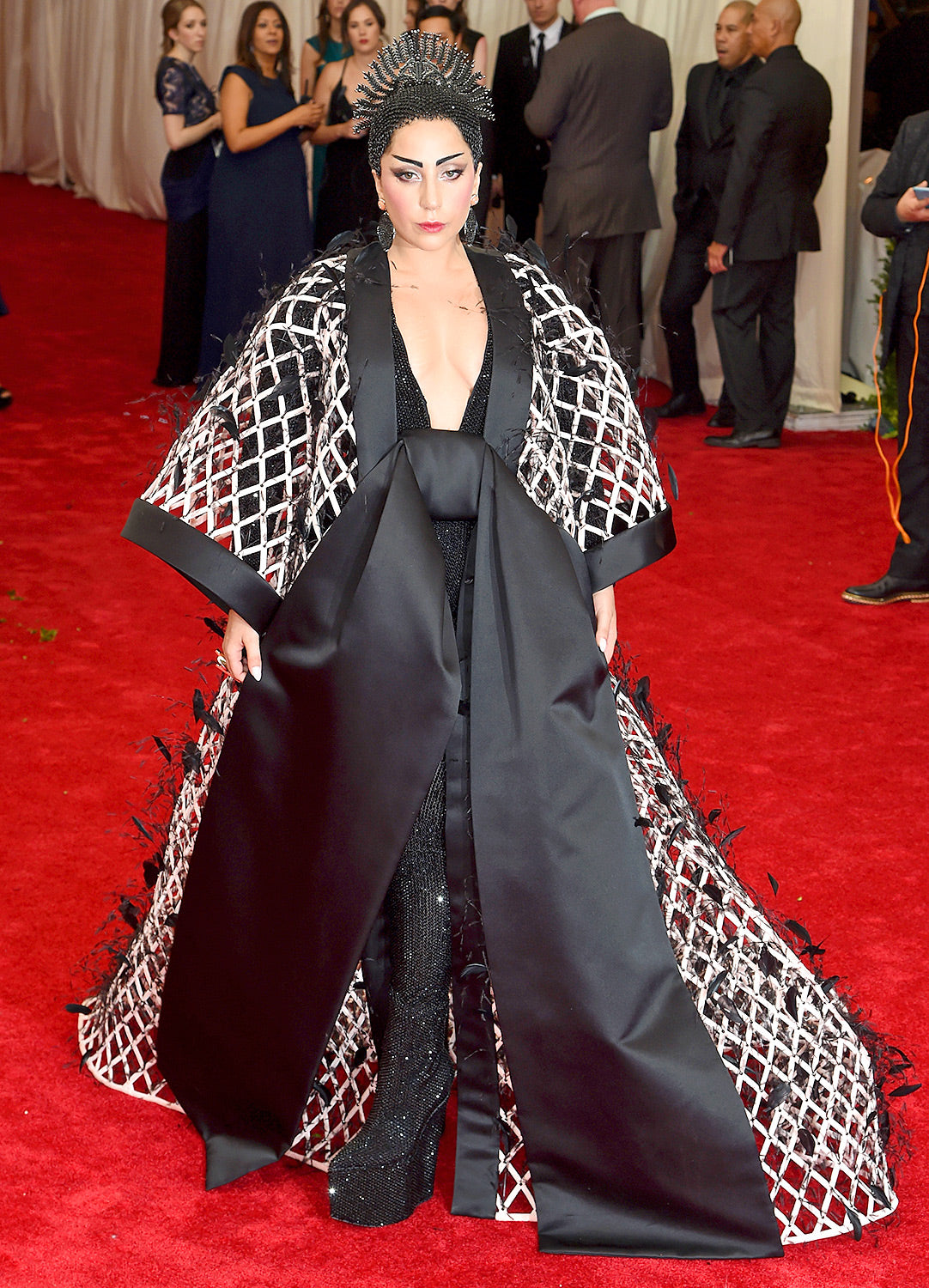 Lady Gaga is used to elaborate clothing. The singer looked relatively tame in this black and white look.
