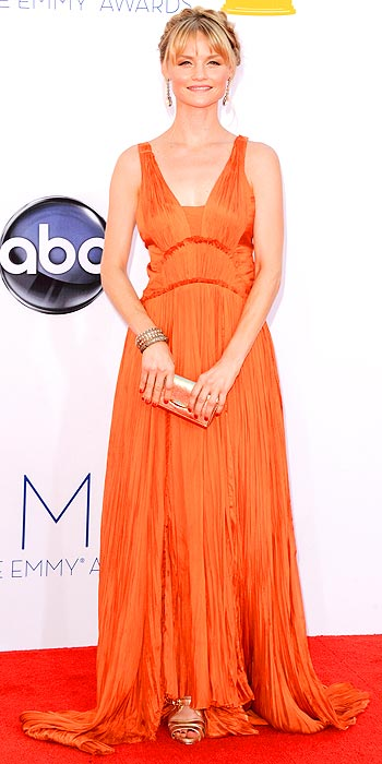 True Blood's Lindsay Pulsipher attends the 2012 Emmy Awards in a blood orange Grecian inspired number