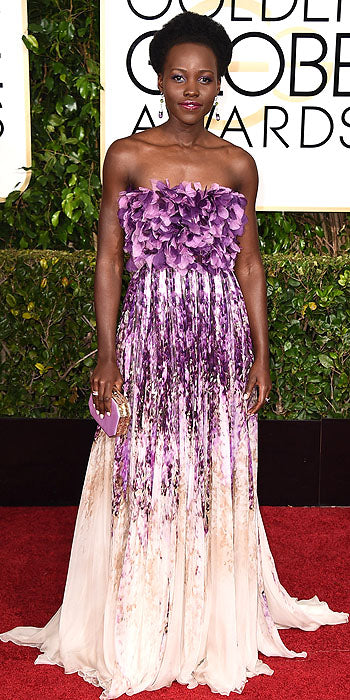 Lupita Nyong'o stood out in a gorgeous embellished Giambattista Valli purple gown.