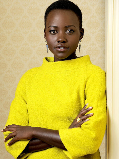 Lupita Nyong'o stuns in yellow. We were first introduced to the actress' penchant for gorgeous colors at  the Toronto International Film Festival.
