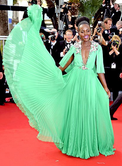 Lupita Nyong'o worked the crowds and apparently mother nature in a gorgeous jade Gucci chiffon gown.