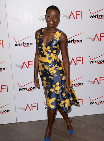 Lupita attends the AFI Movie Awards in a gorgeous blue and marigold sheath