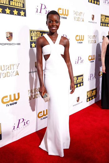 In a custom Calvin Klein ivory silk crepe bandeau dress at the Critic's Choice Awards.
