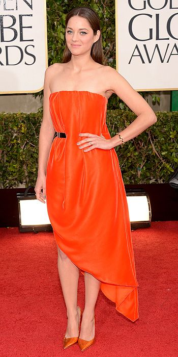 Marion Cotillard stepped out in gorgeous orange but her slanted hemline was a miss