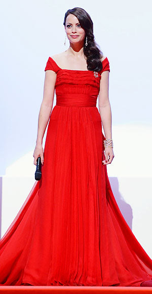 Master of Ceremonies Berenice Bejo opened the Cannes Film Festival in a statement making crimson Louis Vuitton gown