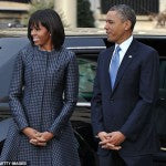 Michelle Obama attended church service in a Thom Browne Coat which was made from fabric inspired by a man's silk tie