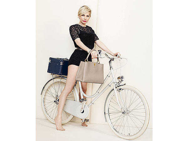 Neutrals meet casual chic - Michelle Williams rides a bike for Louis Vuitton
