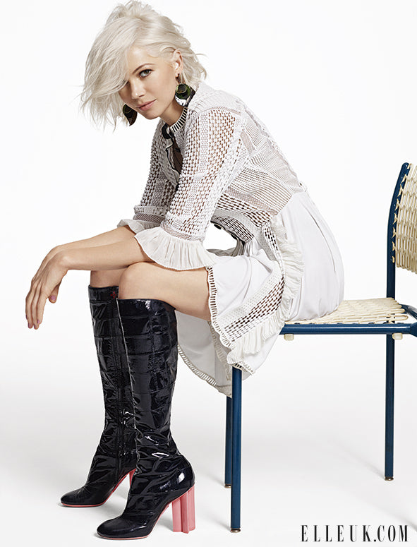 Michelle Williams stuns in Louis Vuitton and messy platinum locks.