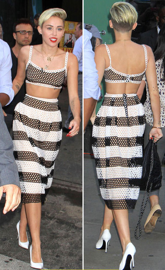 Miley Cyrus in another crop top look at a recent outing at Good Morning America