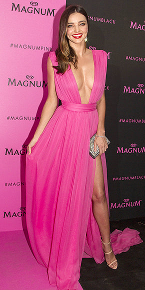 Miranda Kerr rocked a plunging neckline and thigh high slit in pink Emmanuel Ungaro.