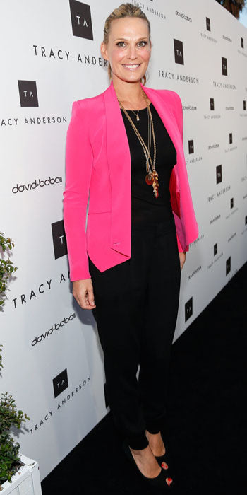 Molly Sims added a pop of color to her all black look with a hot pink blazer