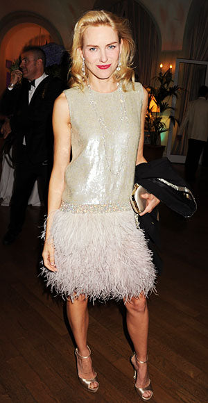 Naomi Watts attends a Gucci party in the label's sequined and feathered dress