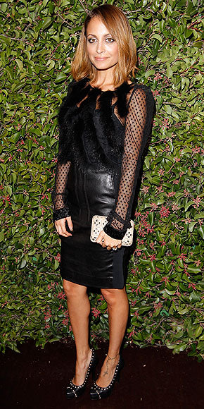 Nicole Richie is a bit more demure in an all black look with sheer polka dot sleeves