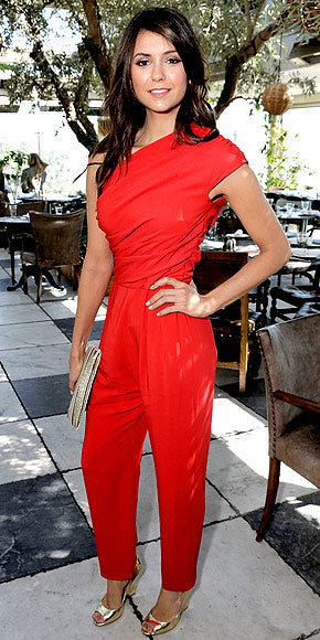 Nina Dobrev attended the luncheon in a bright red Max Mara jumpsuit