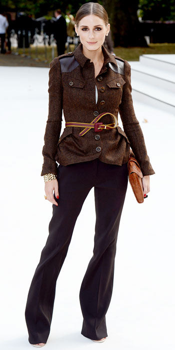 Olivia Palermo attends the Burberry show in the label's stylishly cinched tweed jacket and wide leg trousers