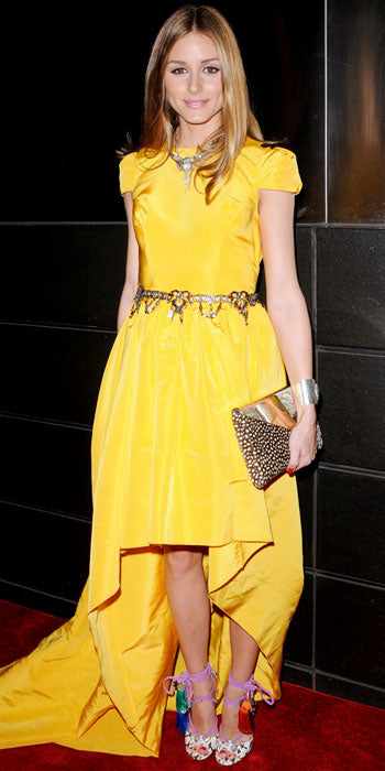 Olivia Palermo brightened up the room in a yellow Katie Ermilio dress and colorful Jimmy Choo heels
