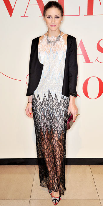 Olivia Palermo layered her intricate evening dress with a black jacket at a Valentino event