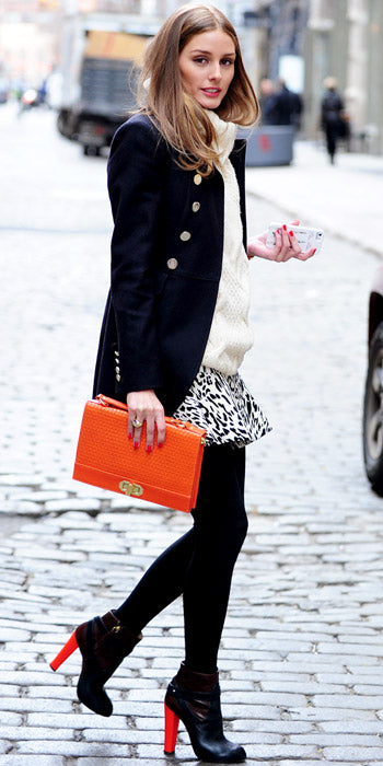 Olivia Palermo looked ever so stylish with the pops of orange color added to her winter wear