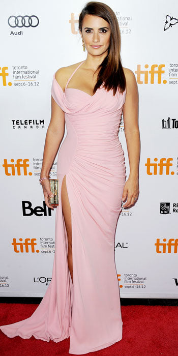 Penelope Cruz wowed at the Toronto Film Festival red carpet for Twice Born in a draped Atelier Versace gown with a thigh high slit