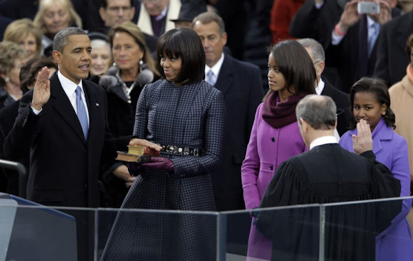 President Obama's family looks on as he is sworn into office by Chief Justice John G. Roberts