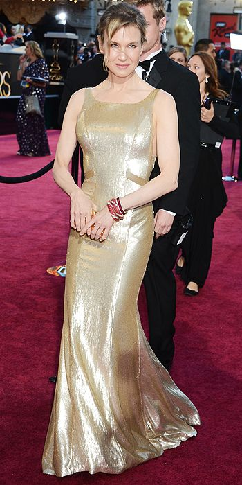 Renee Zellweger opted for a simple gold Carolina Herrera gown